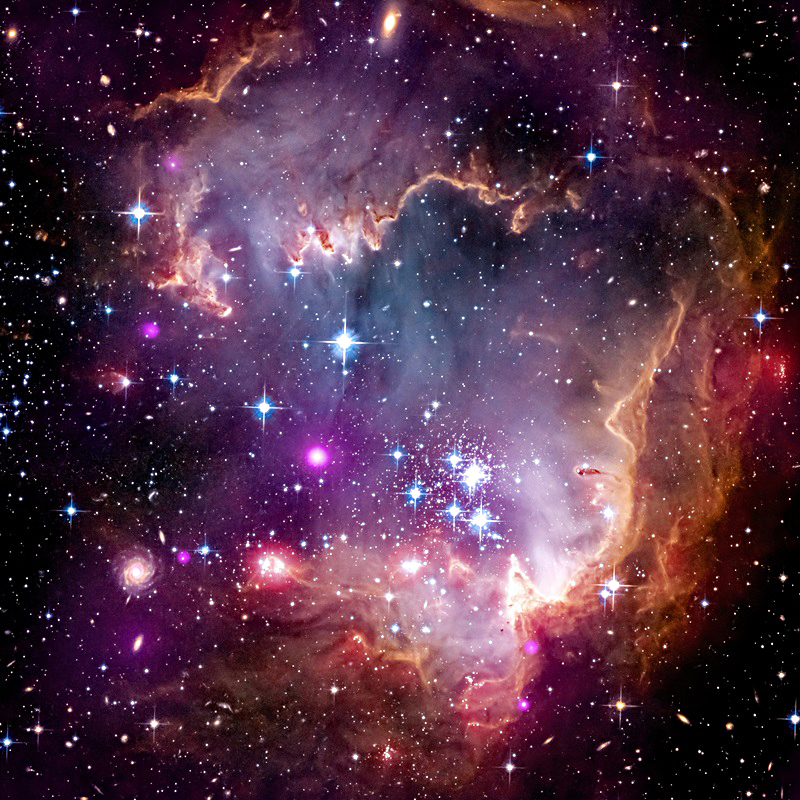 NGC 602 have carved out a cavity in a surrounding cloud of gas and dust.
