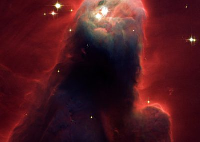 Massive stars off the top of this image emit ultraviolet radiation that erodes the edges of the Cone Nebula (NGC 2264)