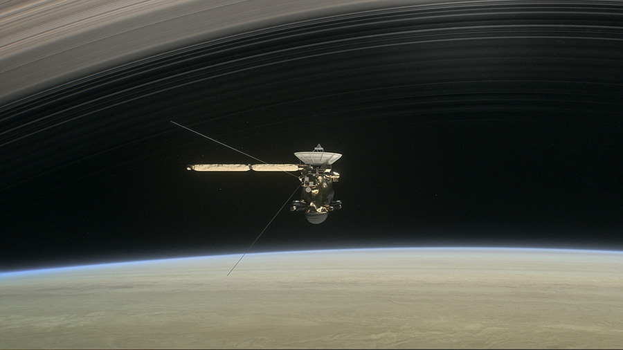 An illustration of Cassini passing through the rings of Saturn