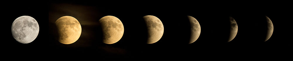A series of seven images of the Moon. Each image shows the Earth's curved shadow crossing over the face of the Moon.