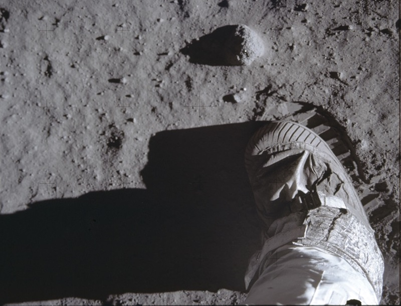A picture of Buzz Aldrin's foot and footprint on the moon.