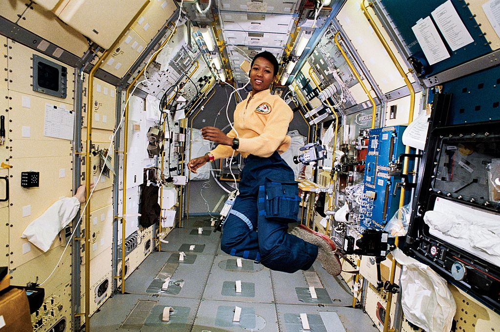 A picture of Mae Jemison floating in the Endeavour space shuttle.