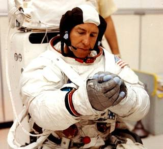 A picture of Jim Lovell in his spacesuit.