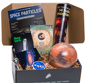 An opened Space & Beyond Box, revealing various items inside
