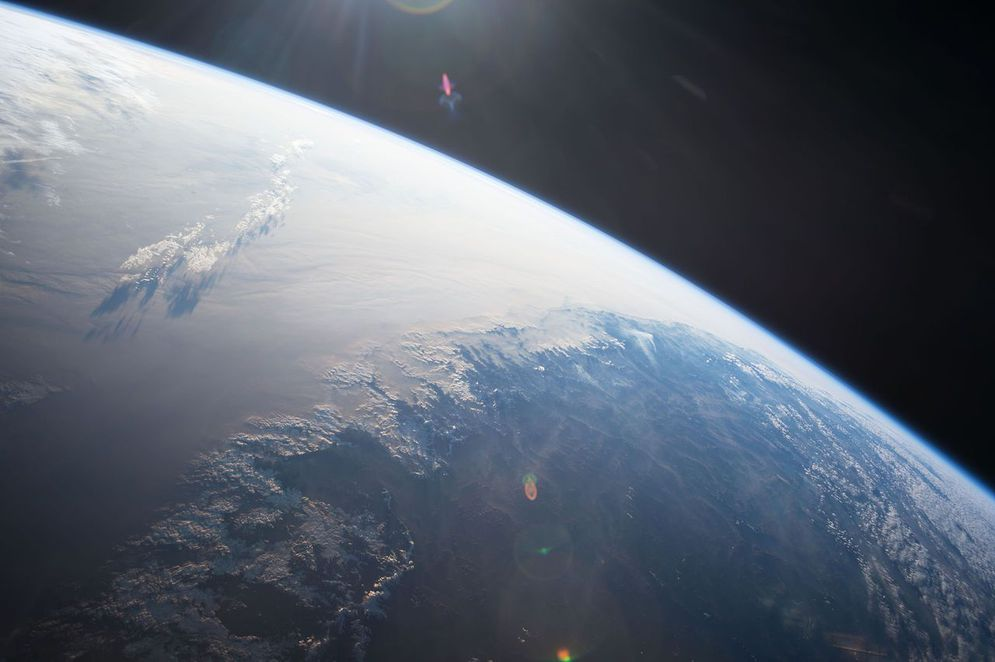 A picture of the round Earth captured by an astronaut from the international space station.