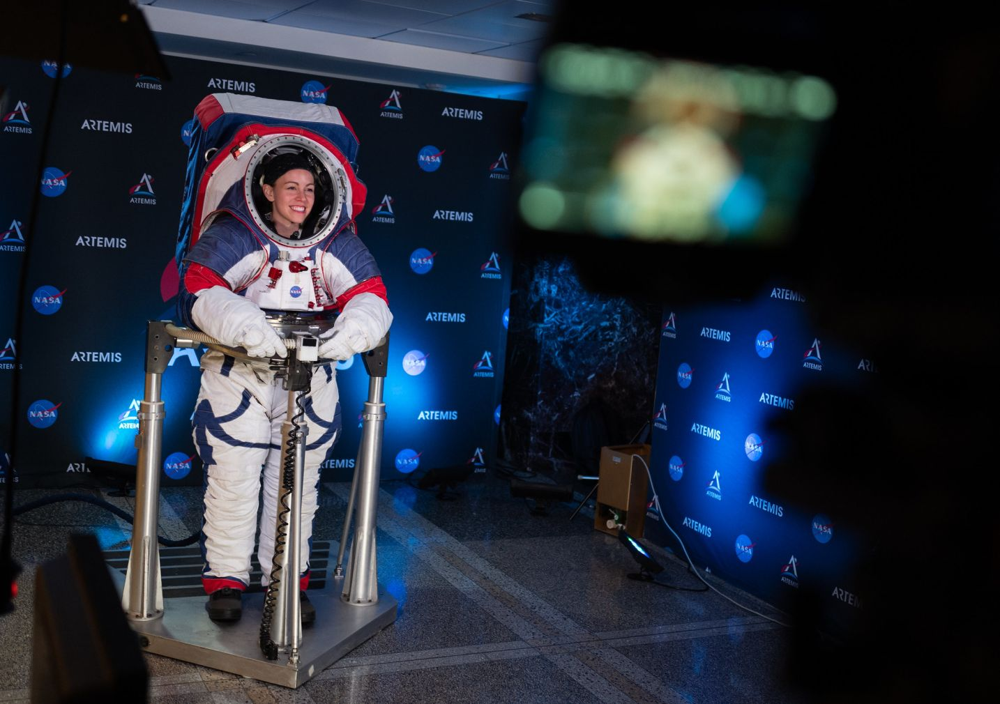 An image of an astronaut wearing a red, white, and blue spacesuit designed to be worn by astronauts exploring the lunar surface.