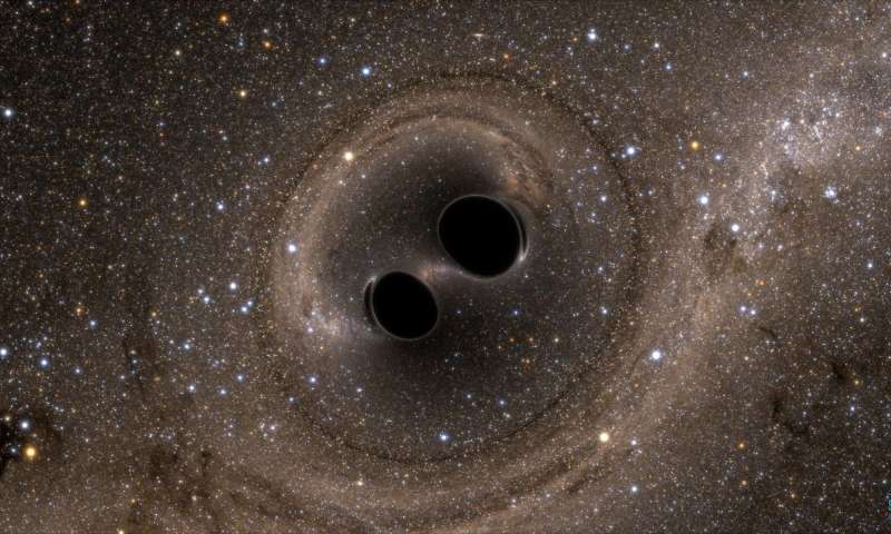 A starry brown sky with two black circles gravitating toward each other in the middle.