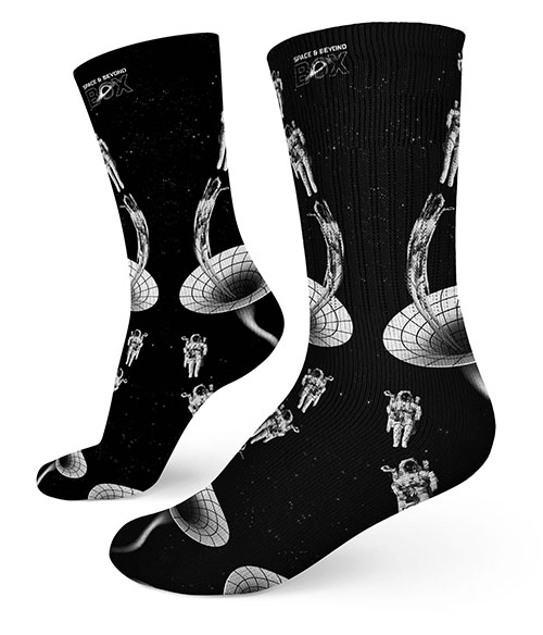 A pair of socks showing an astronaut getting pulled into a black hole