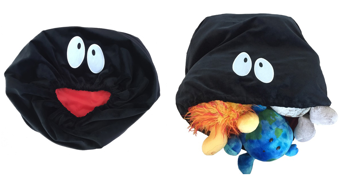 A picture of the celestial buddies black hole plush with plush planets inside
