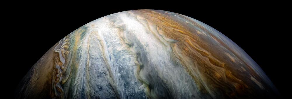 A close up of Jupiter's orange, white, and light blue stripes.