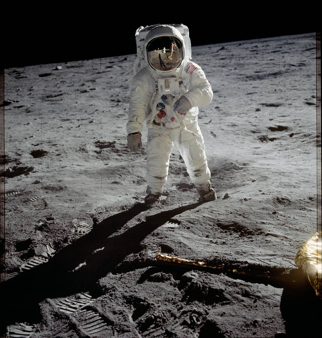 Buzz Aldrin in his astronaut suit standing on the moon