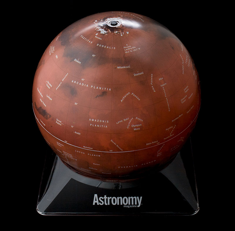 A Mars globe sitting on a black base with the Astronomy logo