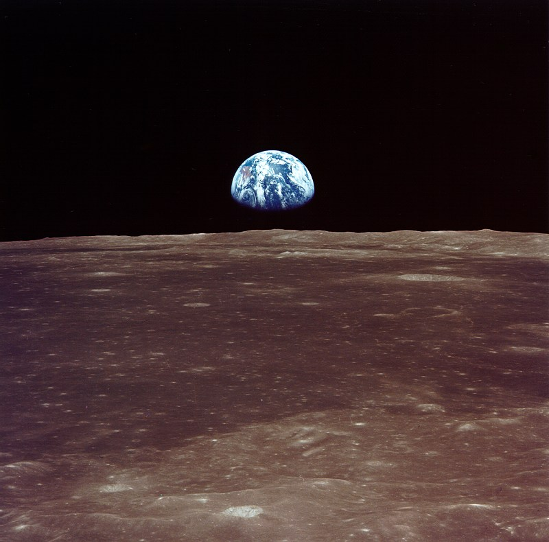 Earth rising above the Moon's horizon