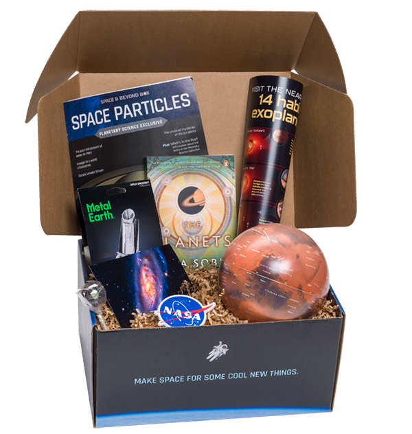 An open box showing a variety of planet themed products