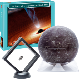 A moon globe, a puzzle of a black hole, and a meteorite in a glass stand