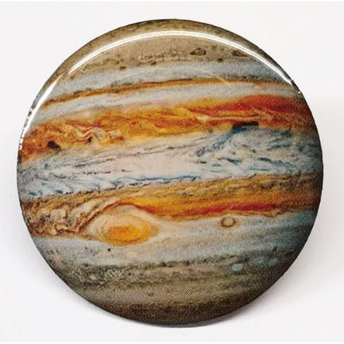 A shiny round pin showing Jupiter