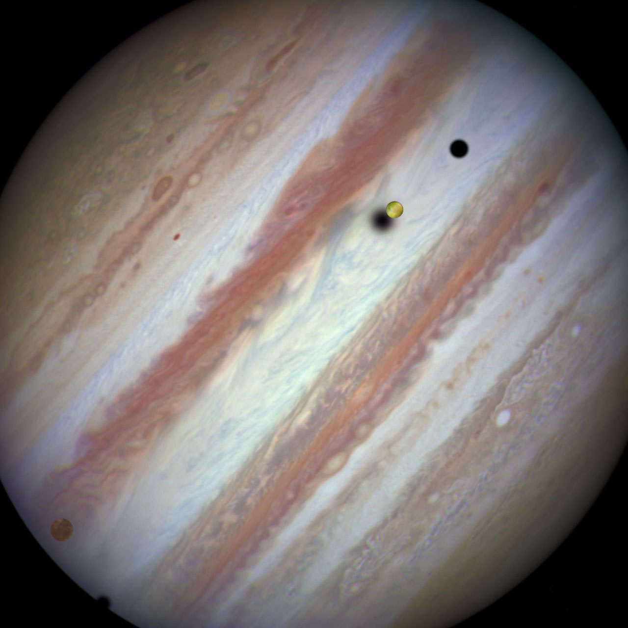 JUpiter with a couple of moons in front of it